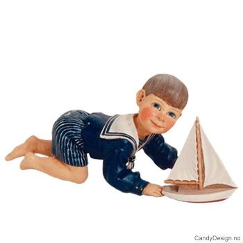 Carl Larsson barn - Gutt med seilbåt