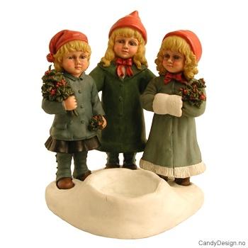 3 julebarn sammen med telysholder
