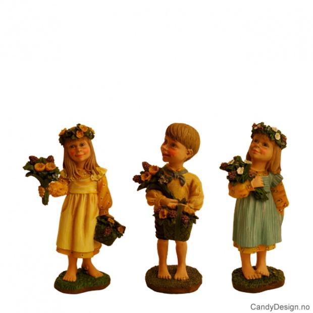 Barn med blomster i gult og blått assortert