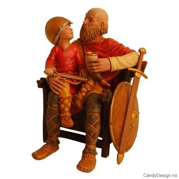 Viking far sittende på trone med gutt med vikinghjelm på fanget i farger