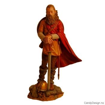 Viking kriger stående med sverd, skjold og hjelm i farger