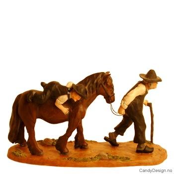 Bestefar med lillegutt til hest